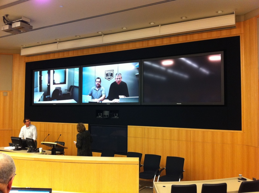 View of the big screens at the front of the Duke Fuqua telepresence classroom